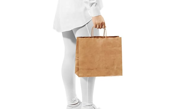 Free Mockup of Woman Carrying Paper Bag