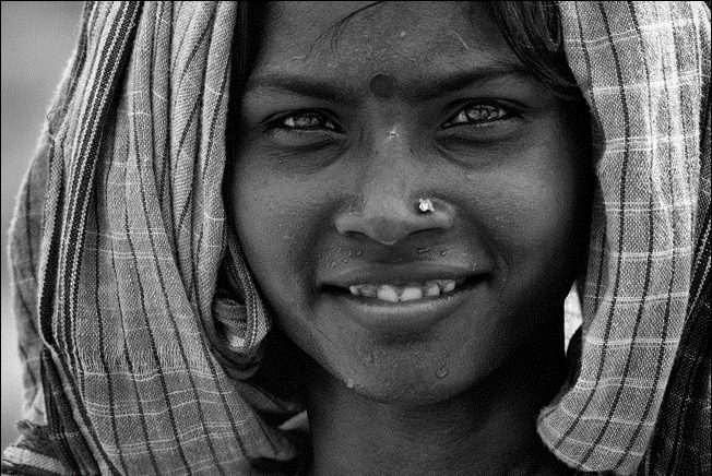 Smile of an Indian female worker By Robert
